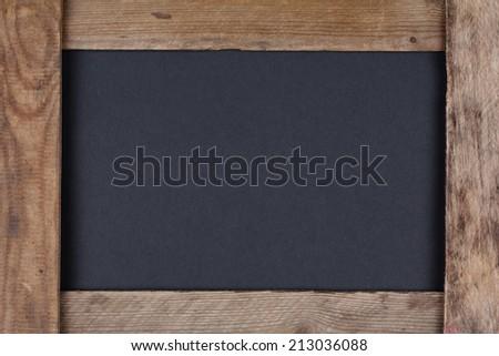 Blank black chalkboard in old wooden frame - stock photo