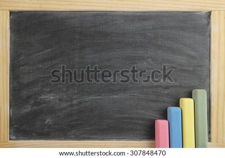 Blank black chalkboard, school board background with chalk - stock photo