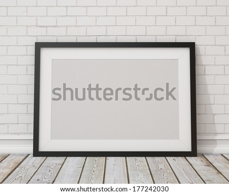blank black horizontal picture frame on the white concrete wall and the vintage floor  - stock photo