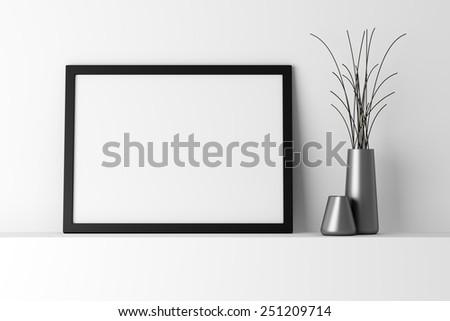 blank black photo frame on white shelf - stock photo