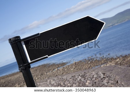Blank Black Sign against Sea Background