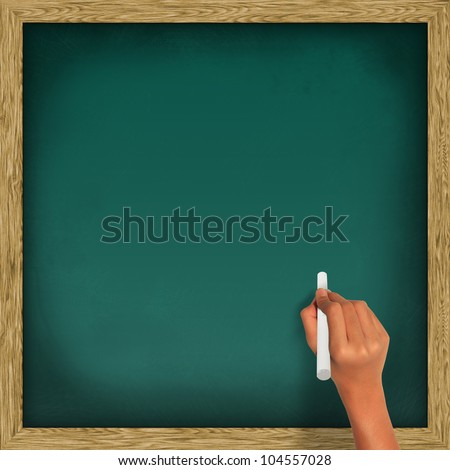 Blank blackboard, chalkboard and hand holding a white chalk, with clipping path - stock photo