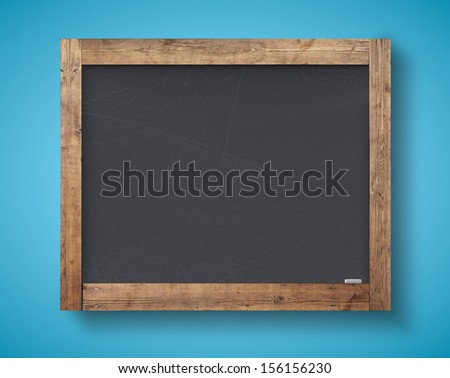 blank blackboard on a blue wall