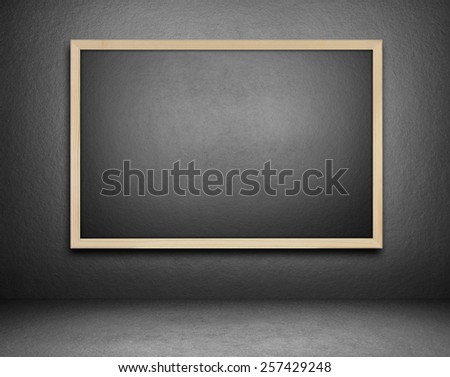 Blank blackboard on cement background - stock photo