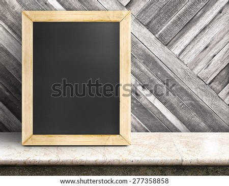 Blank blackboard on marble table at diagonal wooden wall,Template mock up for adding your design and leave space beside frame for adding more text - stock photo