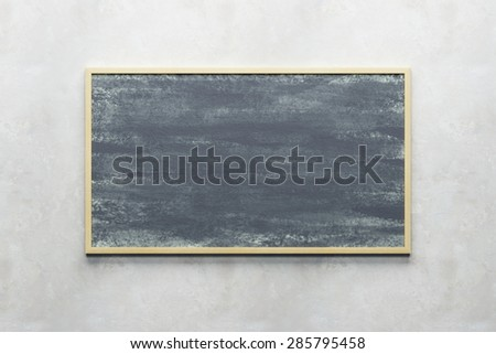 blank blackboard on the wall - stock photo