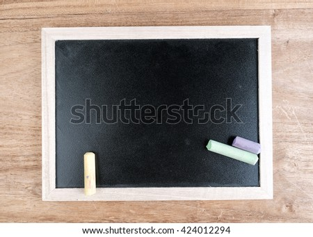 Blank blackboard on wooden background.concept of education.