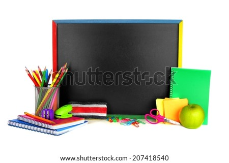 Blank blackboard with school supplies surrounding over a white background - stock photo