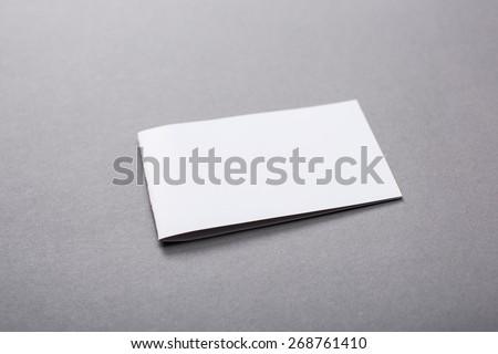 Blank. Blank closed horizontal magazine isolated on grey background with soft shadows - stock photo