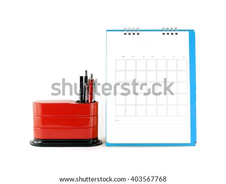 blank blue calendar with red desk organizer on white background, business planner concept - stock photo