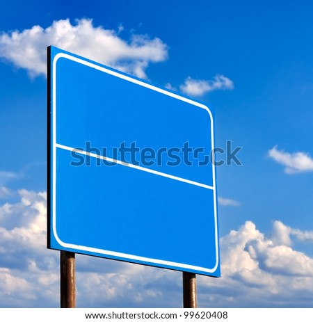 Blank Blue Road Sign Against Light Cloudscape, Summer Sky And Clouds - stock photo