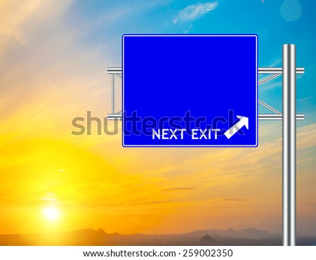 Blank Blue Road Sign concept with resplendent clouds and sky. - stock photo