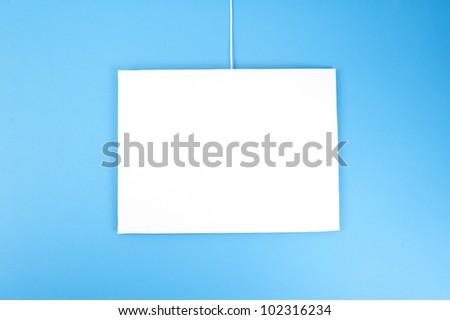 blank board on blue background - stock photo