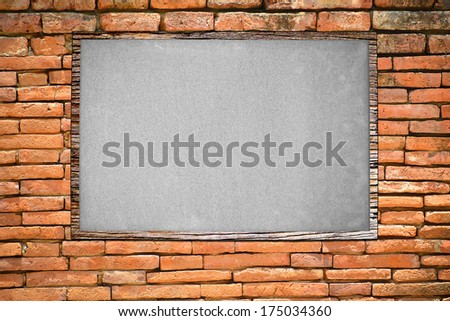 Blank board on brick wall background