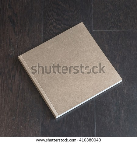 Blank book catalog magazines brochure note cover template w/ recycle brown paper texture, dark color wood table/ wooden floor background: Eco friendly empty note book page on timber backdrop for text - stock photo