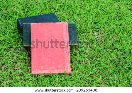 Blank book on grass in a park
