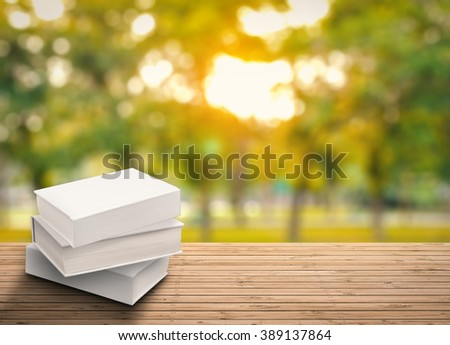 blank book on wood table - stock photo