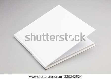 Blank book with ajar white cover 8,5 x 8,5 in - stock photo