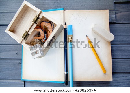 Blank Book with design tools on wood - stock photo
