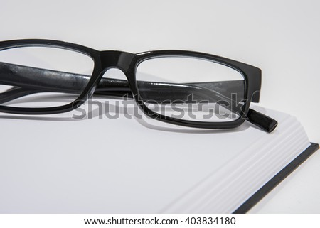blank book with reading glasses
