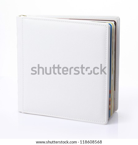 Blank book with white cover on white background.