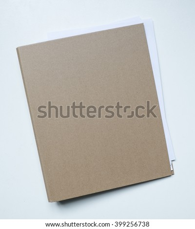 Blank brown card folder file with paper showing isolated on white background. - stock photo