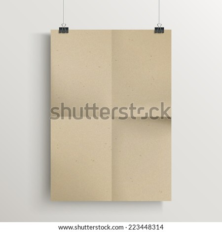 blank brown poster template hanging over wall - stock photo