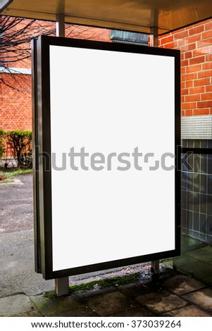 Blank bus stop advertising billboard on empty street as copy space for outdoor poster ad mock up. - stock photo