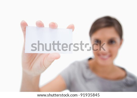 Blank business card being presented by smiling woman against a white background