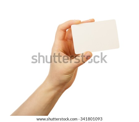 Blank business card in a female hand isolated on white background
