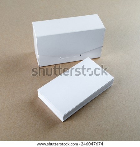 Blank business cards and a box for them on the table. Template for branding identity.