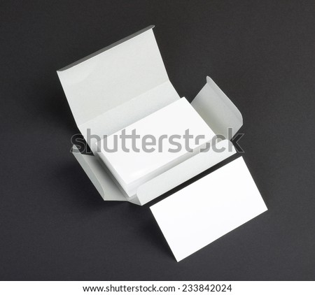 blank business cards on a gray background - stock photo