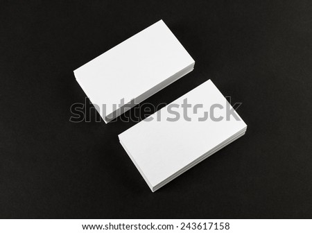 Blank business cards on black background. Mock-up for ID. - stock photo