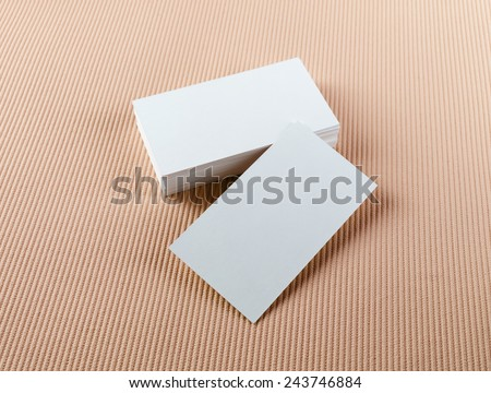 Blank business cards on color background. Mock-up for branding identity. - stock photo