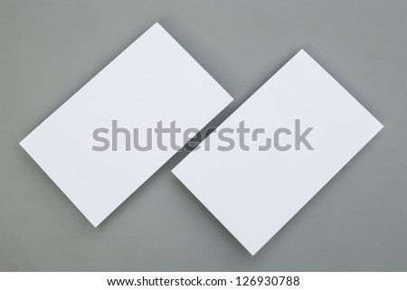 blank business cards on grey background - stock photo