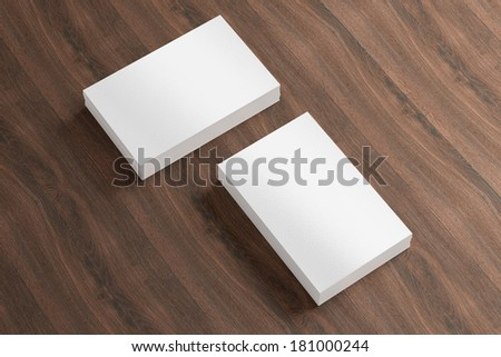 Blank business cards with soft shadows on wooden background to replace your drsign - stock photo