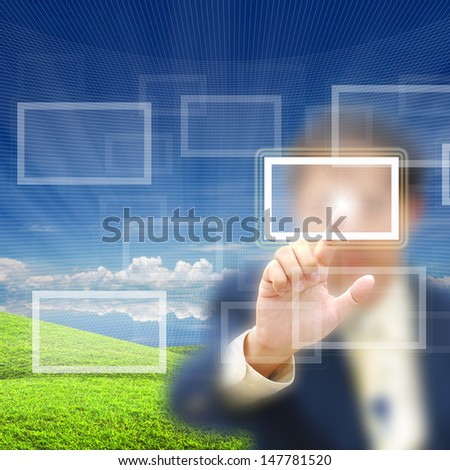 Blank button on modern computer screen with business person.