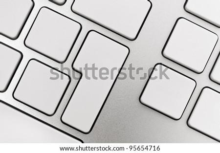 Blank buttons on modern aluminum keyboard. - stock photo