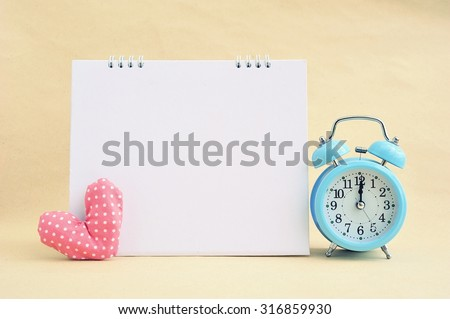 Blank calendar,clock and heart on old paper. - stock photo