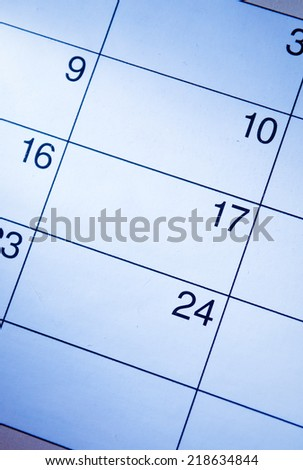 Blank calendar with generic date squares with a highlight over the 17th and copyspace, closeup view from above - stock photo