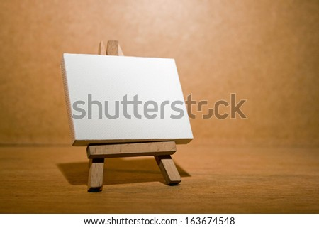 Blank canvas on a artist' easel.
