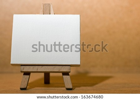 Blank canvas on a artist' easel.  - stock photo