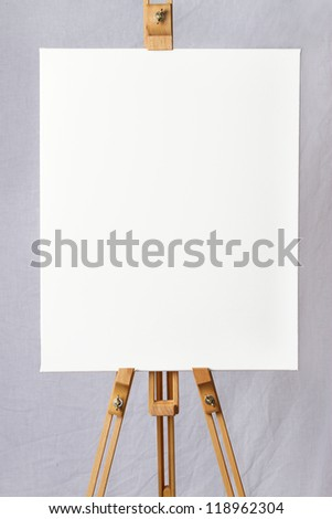 Blank canvas on an wooden easel ready for your own design - stock photo