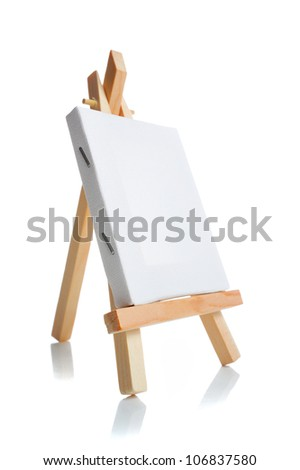 Blank canvas on easel isolate on white background - stock photo