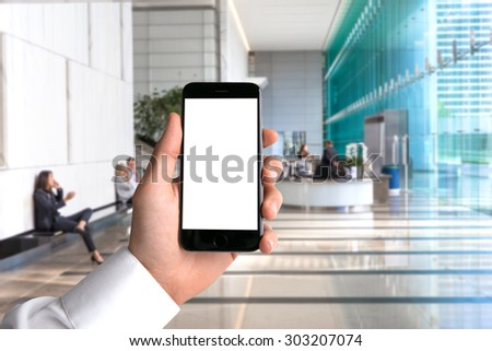 Blank card cell phone smartphone hand POV business man background workplace office perspective point of view - stock photo