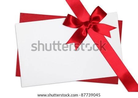 Blank card decorated with red ribbon bow - stock photo