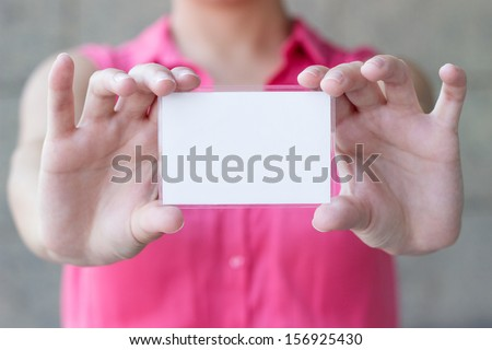 Blank card in a hand  - stock photo