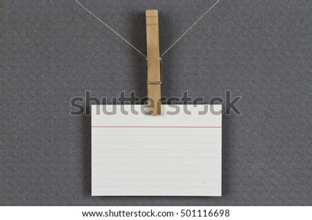 blank card pinned up on a pinboard