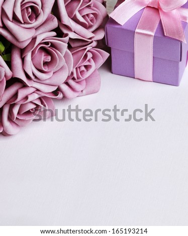 blank card with purple roses and purple gift box - stock photo