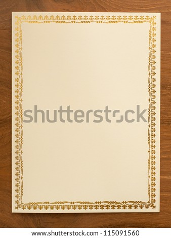 blank card with thai traditional frame on wooden desk - stock photo